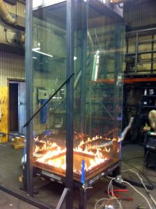 Tall Glass Fireplace in Production