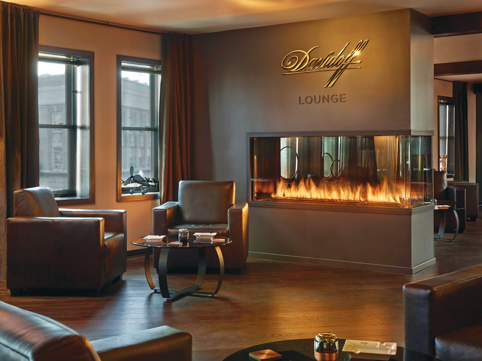 Custom 3 sided peninsula gas fireplace in cigar lounge acucraft teraionfo