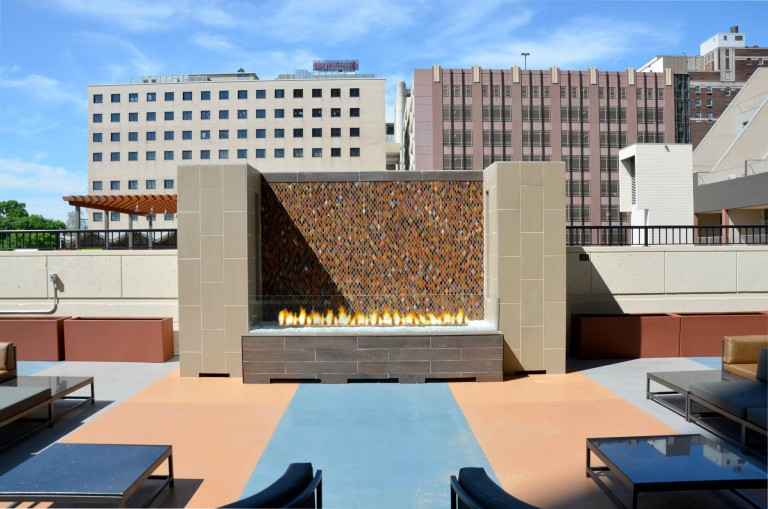 custom outdoor linear gas fire pit on apartment rooftop lounge