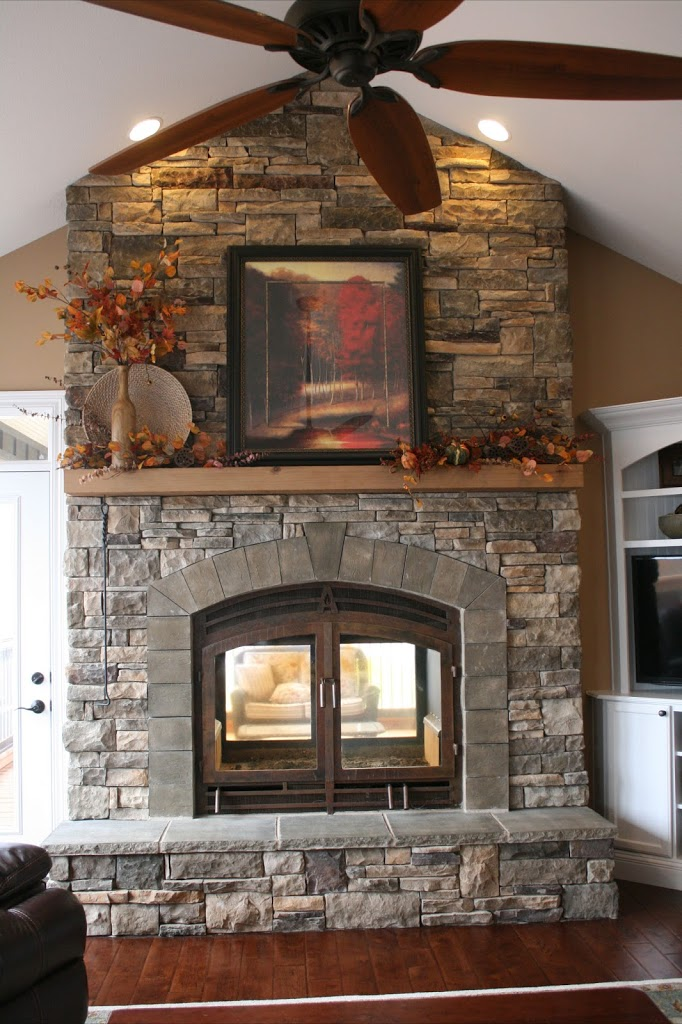 Indoor-Outdoor See-Through Fireplace with Decorated Mantle