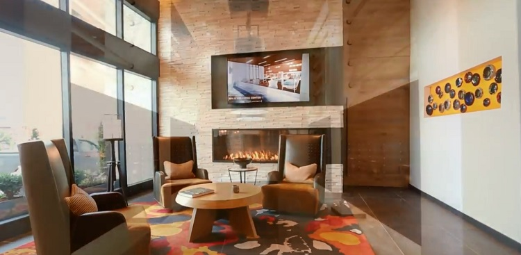 multi sided custom gas fireplace in lobby