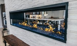 linear fireplace with glass barrier and blue crushed glass media