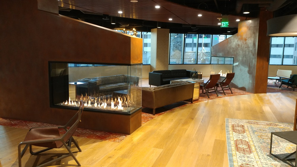 3 sided peninsula gas fireplace in employee lounge at fifth street towers minneapolis
