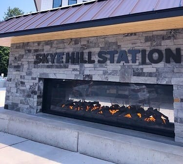 acucraft custom gas outdoor see through fireplace with logs in starbucks