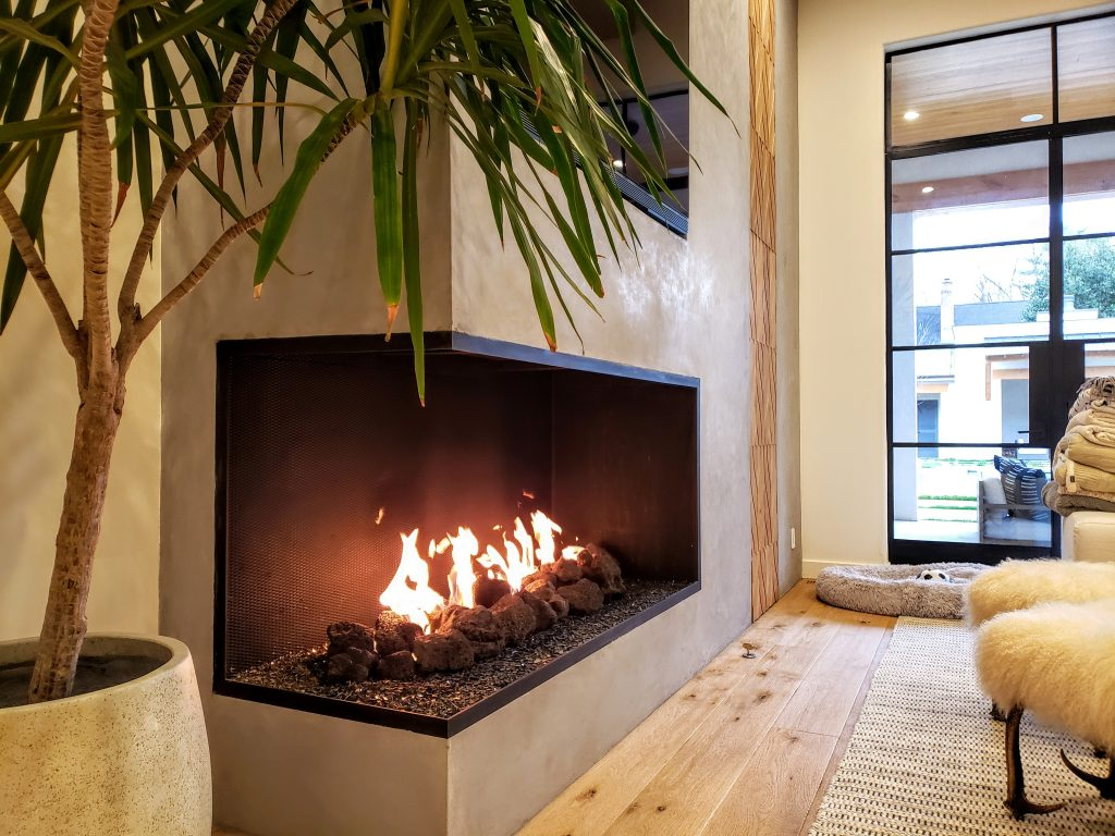 open multi view fireplace with firescreen in modern home