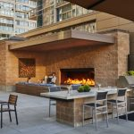 custom outdoor open gas fireplace on apartment rooftop shared space