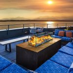 outdoor gas fire table fire pit on rooftop deck overlooking the ocean