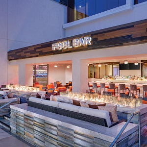 acucraft dual custom outdoor fire tables at pool bar in casino