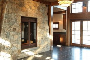 large custom wood burning fireplace in private residence entryway