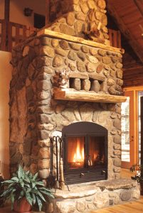 great room high tech wood burning fireplace with masonry finish