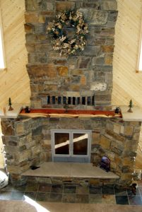 great room single sided wood burning fireplace with masonry finish