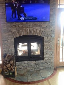 see through wood burning fireplace in residential home