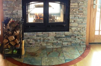 indoor outdoor see through wood burning fireplace in cabin