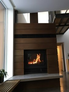 single sided modern wood burning fireplace in private residence