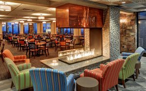 acucraft peninsula 3sided gas fireplace with open viewing area in ski resort restaurant