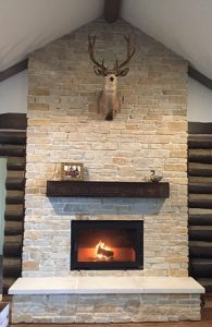 single sided wood burning fireplace with clean face in residential home