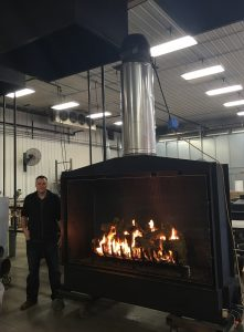 open gas fireplace with log set being tested in test labl