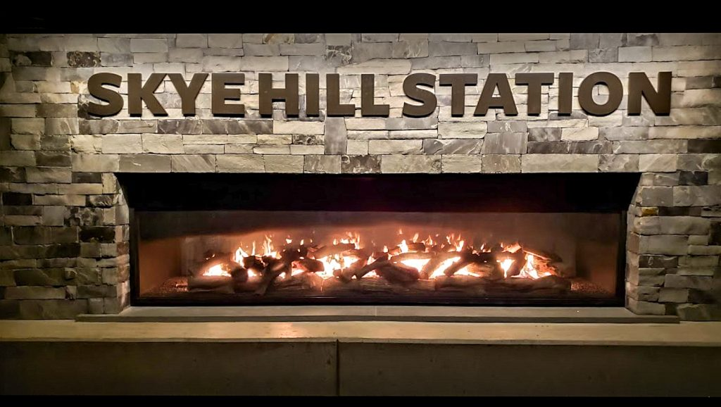 Acucraft custom outdoor see through gas fireplace at Skye Hill Station