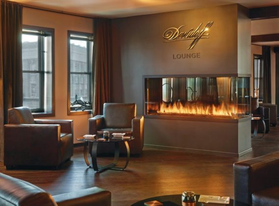 peninsula 3 sided custom gas fireplace in davidoff cigar lounge
