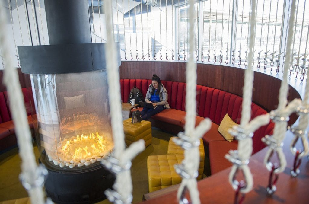circular gas fireplace in sunken lounge at Google headquarters