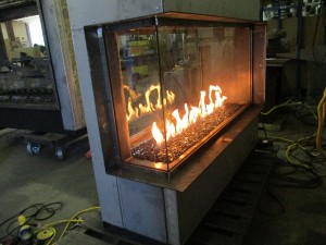 see through corner gas fireplace being tested