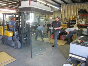 four sided glass for custom fireplace being manufactured