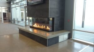 panoramic 3 sided gas fireplace in corporate headquarters