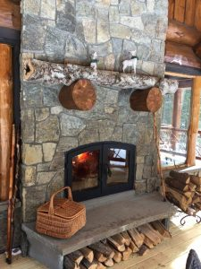 see through indoor outdoor wood fireplace exterior side