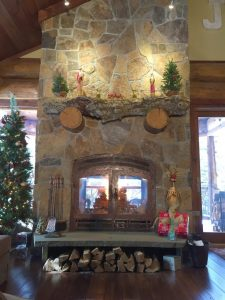 indoor outdoor see through wood burning fireplace in new construction home