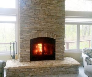 indoor outdoor wood fireplace in new construction home