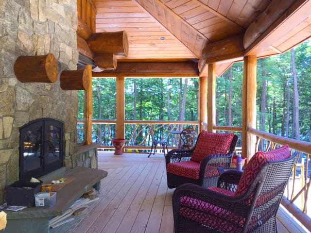 see through indoor outdoor wood burning fireplace exterior side deck