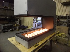 Custom 3-Sided Peninsula Gas Fireplace by Acucraft