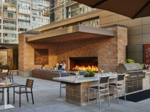 linear outdoor open gas fireplace on rooftop lounge