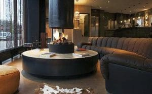 circular gas fireplace in contemporary hotel lobby