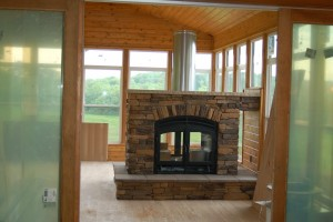 Double-Sided Indoor Fireplace with Exposed Flue