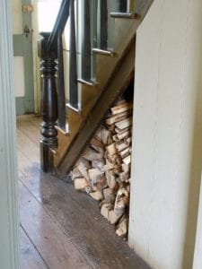 wood storage underneath stairs