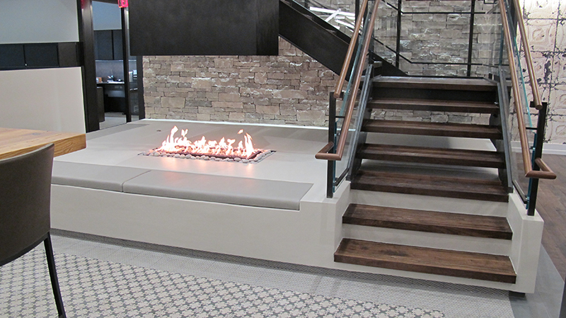 custom open gas fireplace with suspended hood in corporate office