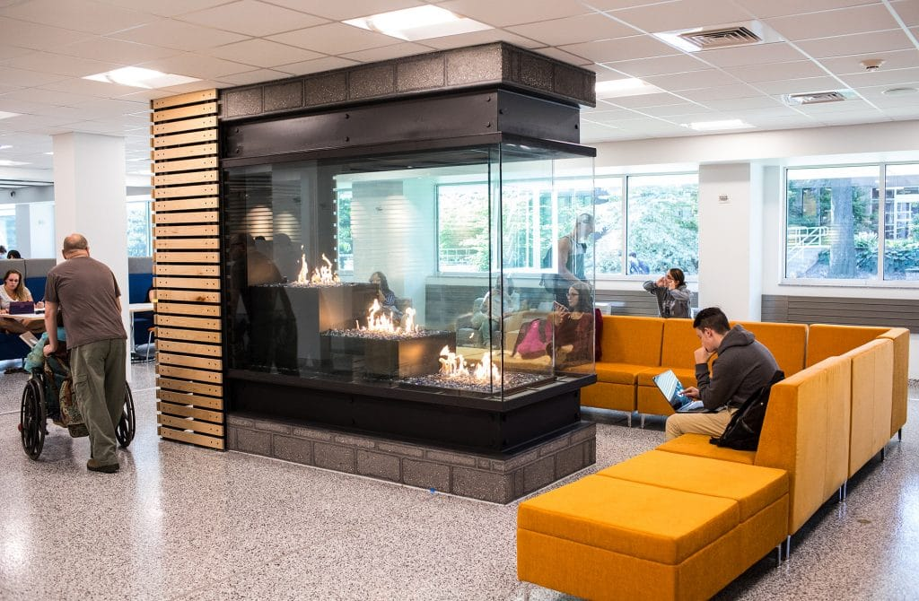 3 tiered peninsula gas fireplace in community college lounge