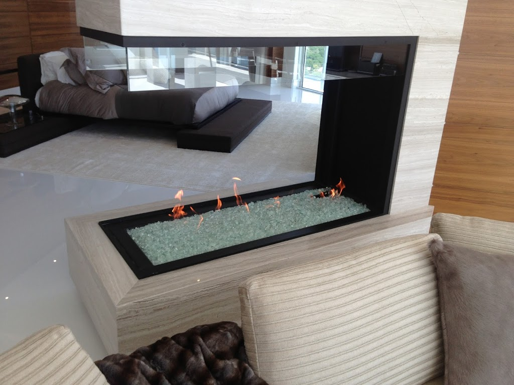 3 sided peninsula gas fireplace with open viewing area in modern bedroom
