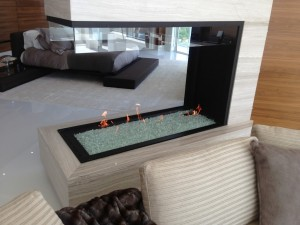 peninsula 3 sided gas fireplace with suspended glass