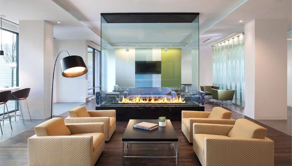 four sided glass gas fireplace in lobby