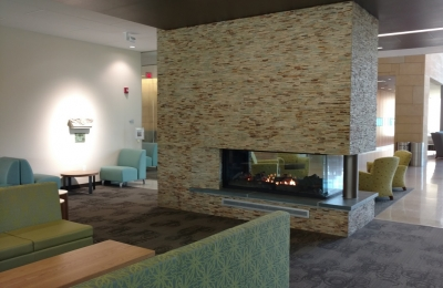 3 sided see through gas fireplace in university lounge