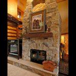 see through wood burning fireplace with masonry finish