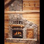 single sided wood burning fireplace with masonry surround