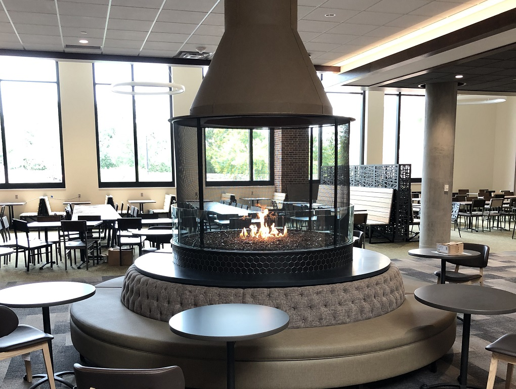 circular gas fireplace with firescreen and glass barrier
