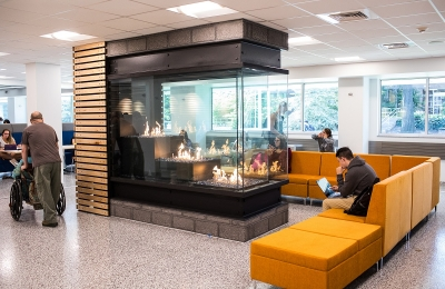 peninsula gas fireplace with tiered burner in student lounge