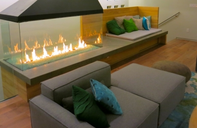 4-sided glass fireplace in contemporary living room