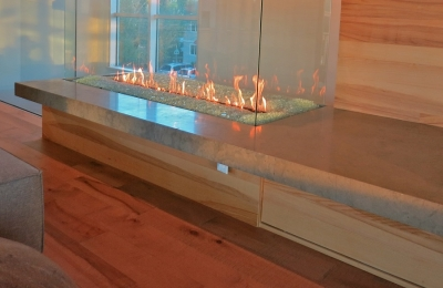 four sided glass fireplace in modern home