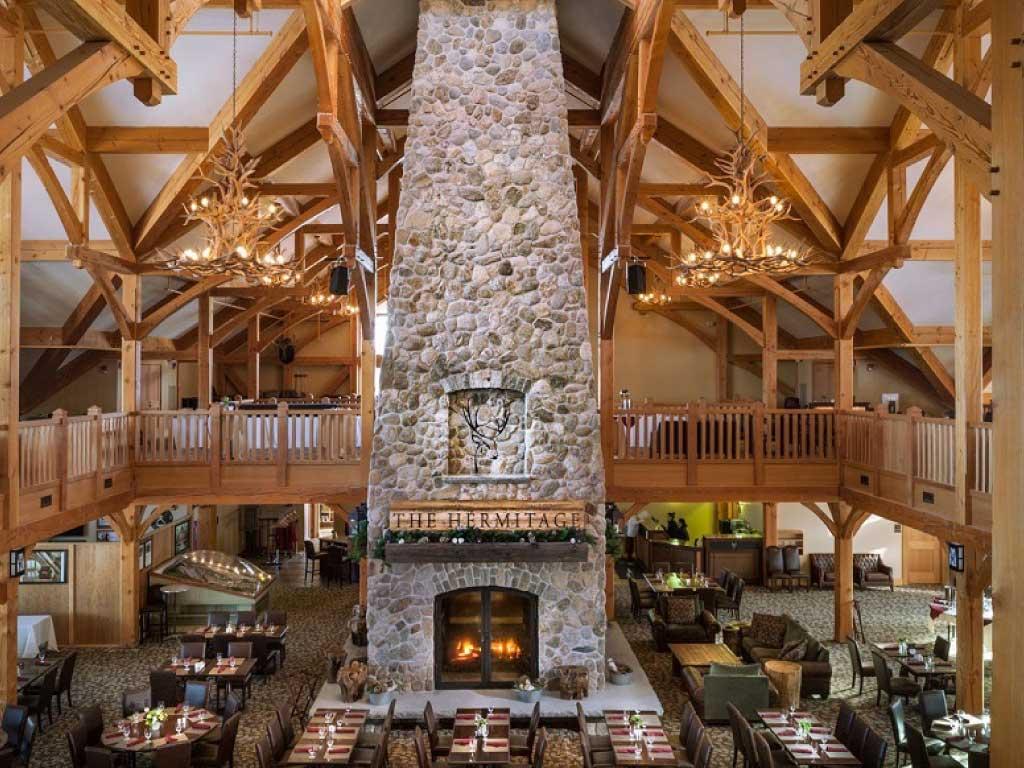 custom four sided wood fireplace at ski lodge