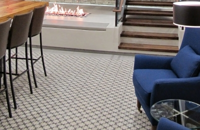four sided open gas fireplace in modern office space
